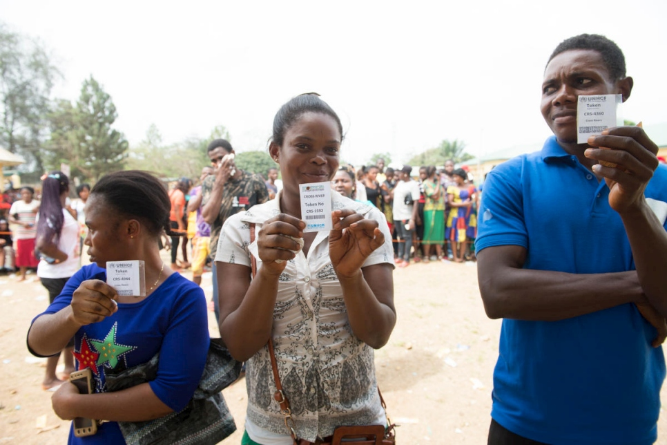 Nigeria. Cameroonian refugees wait to be verifed with their food tokens for relief materials and food distribution in Ikom