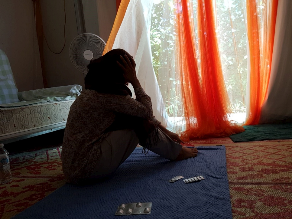 A young Afghan refugee woman, separated from her parents in Australia, looks out of the tent where she has lived for the past five years in Nauru. March 2018.
