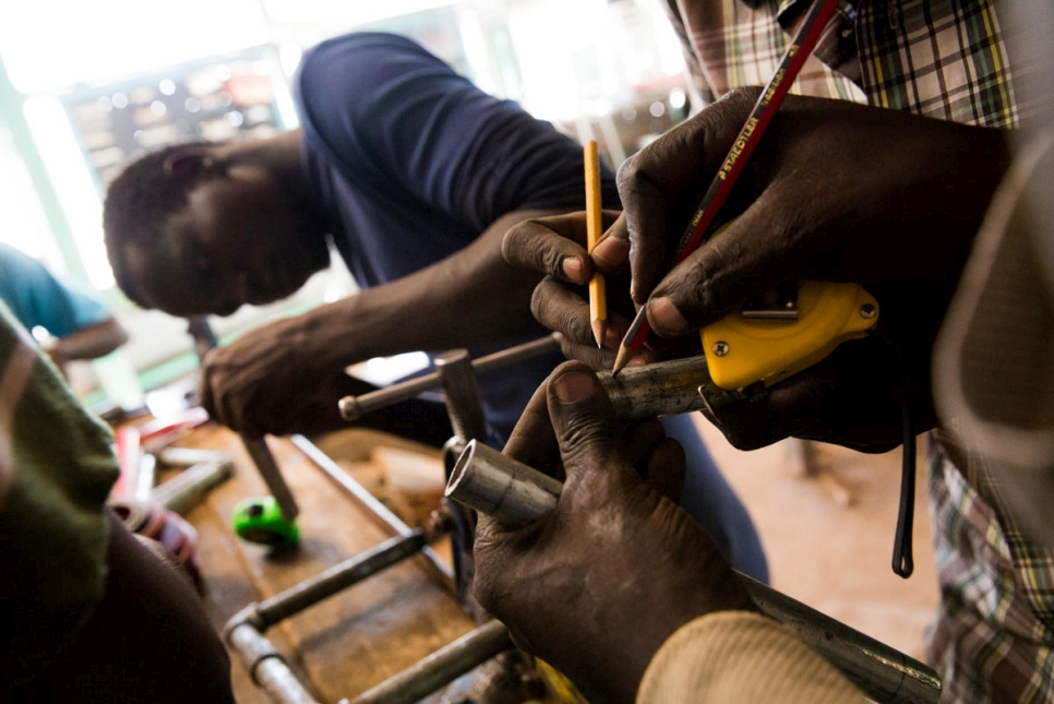 Refugees take tailoring classes in the Kakuma camp.