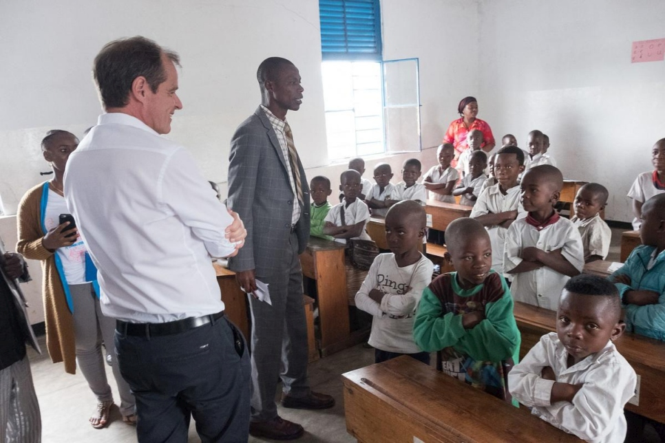 Germany's Ambassador to the DRC, Thomas Terstegen (left), visits a new classroom at Walugaba Primary School in Rusayo, where formerly displaced children have been reintegrated.