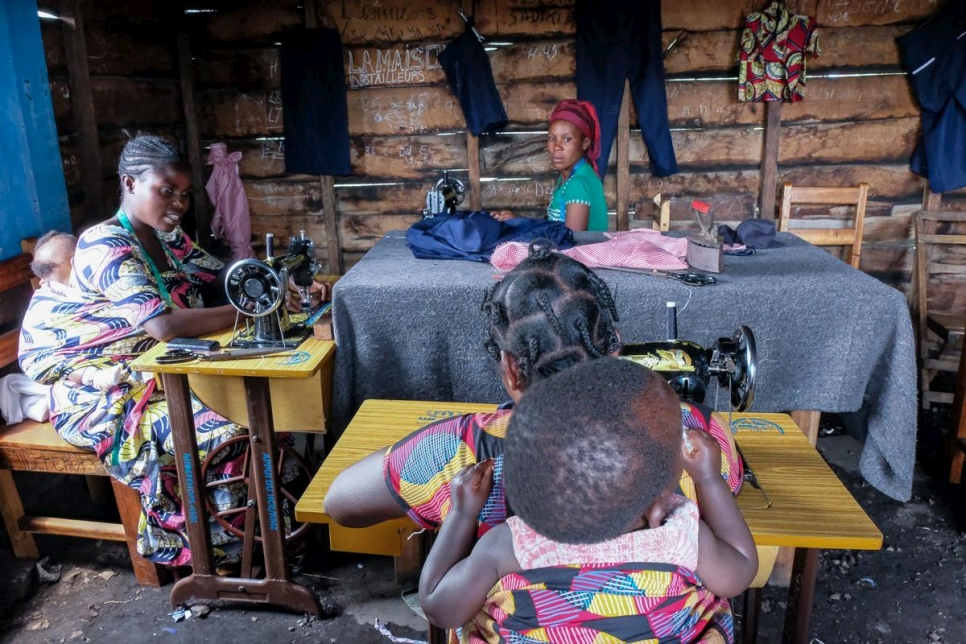 Formerly displaced women attend a tailoring class in Rusayo, DRC under the UNHCR reintegration project.