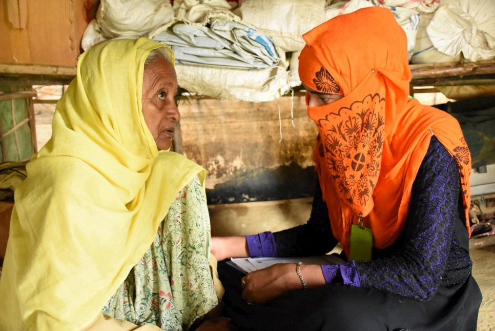 A community health worker counsels a 70-year-old Rohingya refugee.