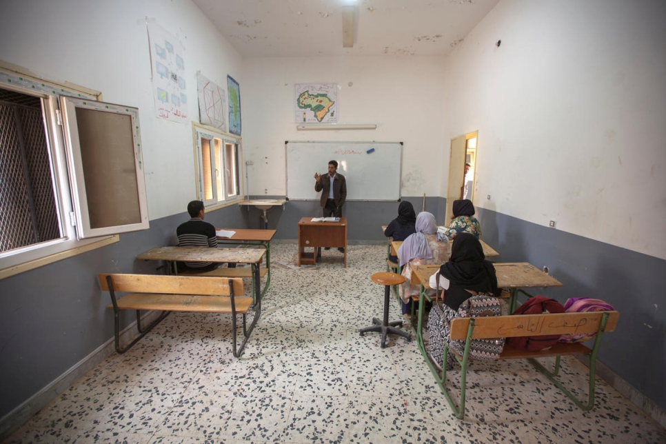 Libya. Mohamed teaching the few returnee children that still attend school in Gwalish