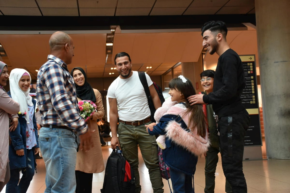 Refugee from Syria welcomes parents and siblings after family reunification in Germany