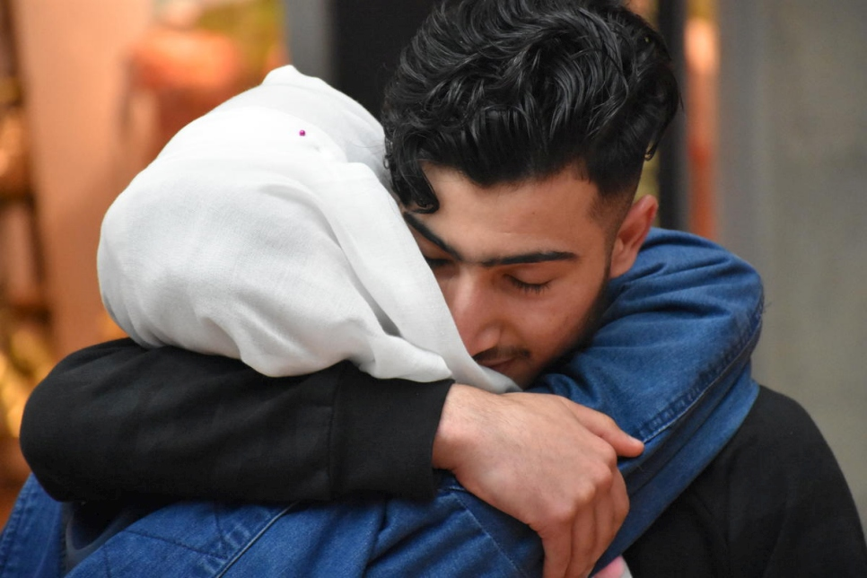 Refugee from Syria greets mother after family reunification in Germany