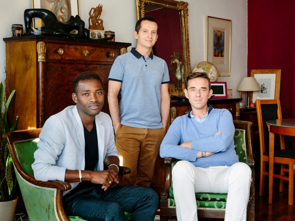 Christophe and Armand host Louis (left), a refugee from Mali, in their one bedroom apartment in Paris. Louis was persecuted because of his sexuality and his activities in the LGBT community.