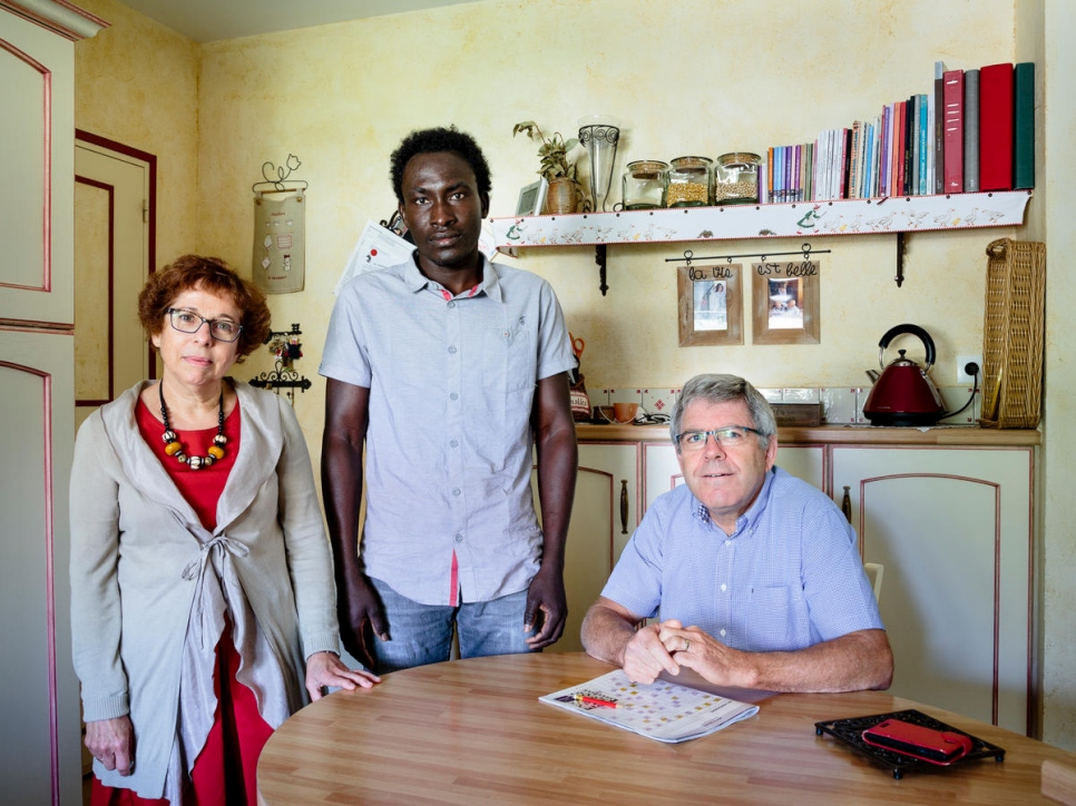 France. Annick and Hubert host Farah, a refugee from Sudan, in Rivière.  This portrait is part of the No Stranger Place series, which portrays locals and refugees living together