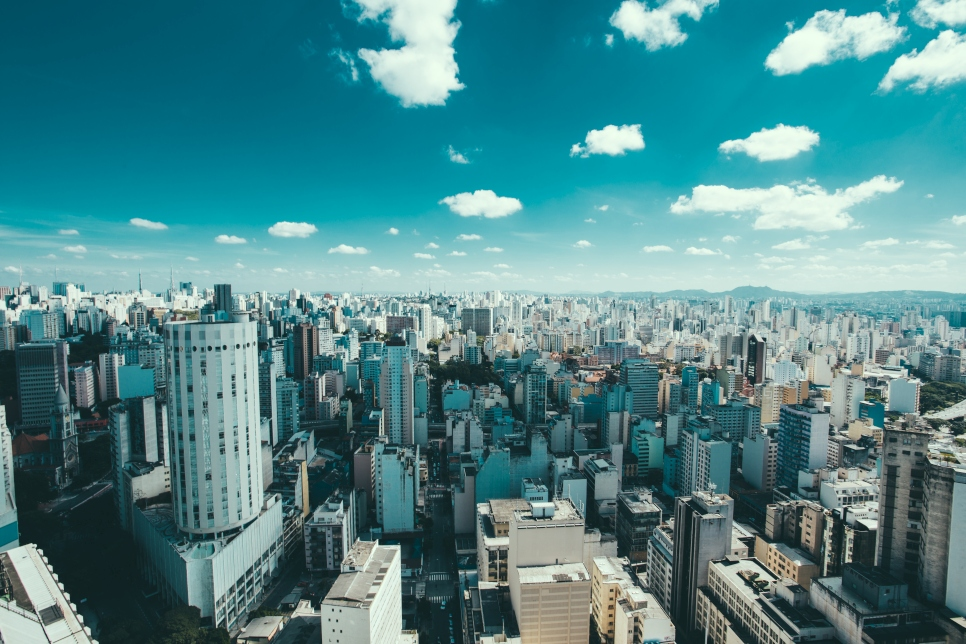 Wide shot of buildings in Sao Paulo, Brazil, with blue sky and clouds overhead