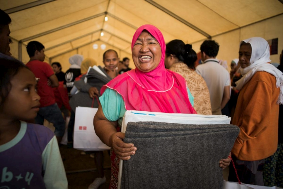 The Philippines. UNIQLO distribution of core relief items on World Refugee Day