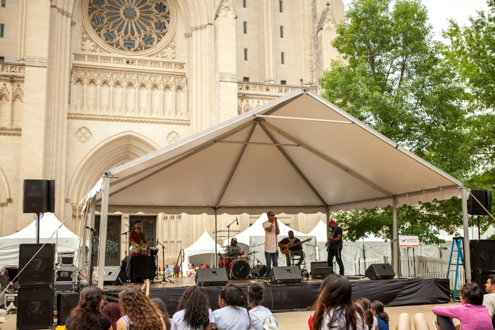 The Washington-based band Leftist performs on the main stage at the One Journey Festival on the grounds of the Washington National Cathedral. The hip-hop band includes musicians from Afghanistan, Côte d'Ivoire, India and the United States.