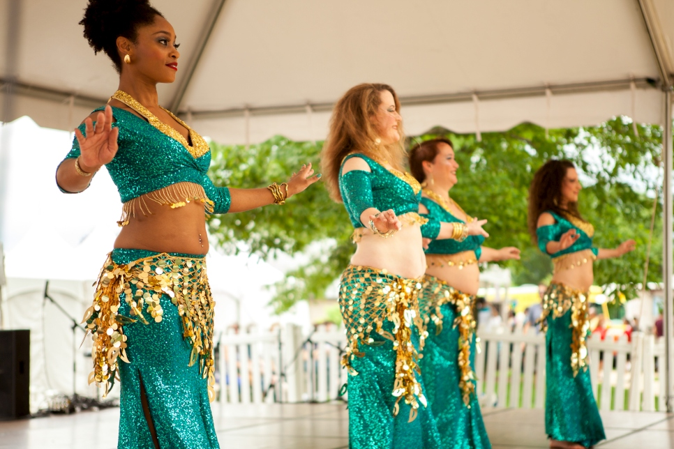 A belly dancing group performs for the crowd at the One Journey Festival. The belly dancers were a crowd favorite, and multiple different groups took to the main stage throughout the day. They also offered lessons to festival-goers later in the day.
