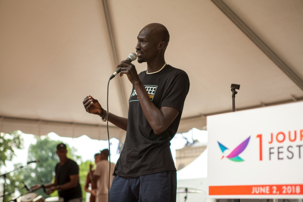 UNHCR Goodwill Ambassador Ger Duany tells his story from the main stage of the One Journey Festival. A former 'lost boy' who fled Sudan, Duany was resettled to the United States and went on to become an actor and model who uses his platform to be an advocate for refugees.