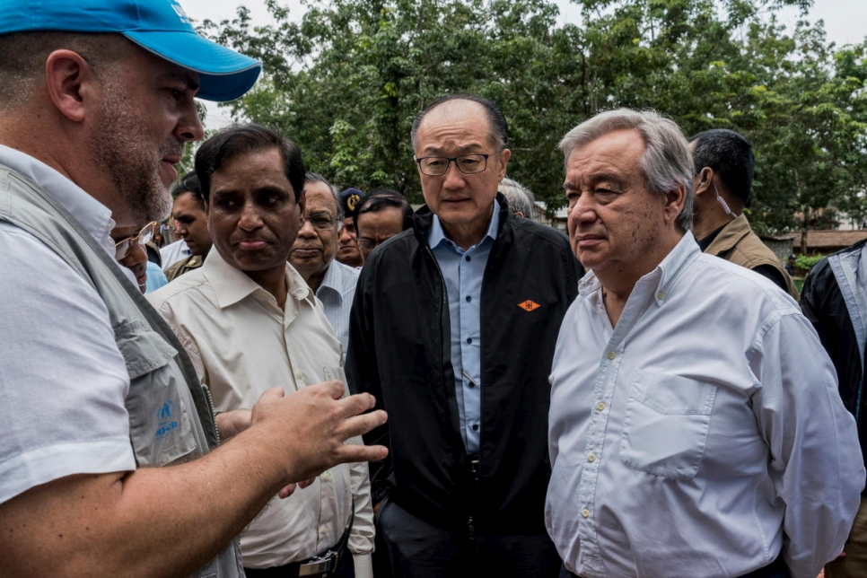 UN Secretary-General António Guterres (right) and World Bank Group President Jim Yong Kim (second from right) receive a briefing from a UNHCR staff member at a UNHCR transit centre for newly arrived Rohingya refugees in Kutupalong, Bangladesh.