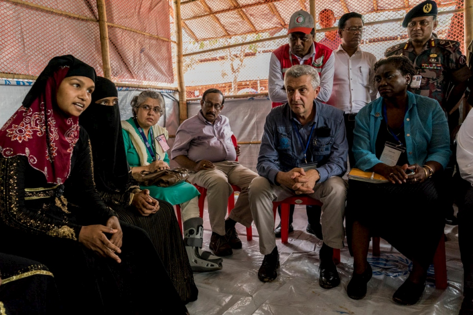Hamida Begum, 18, (left) speaks during a meeting with UN Secretary-General António Guterres, World Bank Group President Dr. Jim Yong Kim, UN High Commissioner for Refugees Filippo Grandi (seated, second from right) and UNFPA Executive Director Natalia Kanem (seated, right) in Kutupalong, Bangladesh.