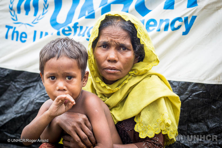 Jamila (42) with her youngest son Mahamoud Jaber (4) at UNHCR's transit centre near Kutupalong camp. Armed men attacked and burned houses in Jamila's village back in Myanmar, sending families like hers running for their lives.