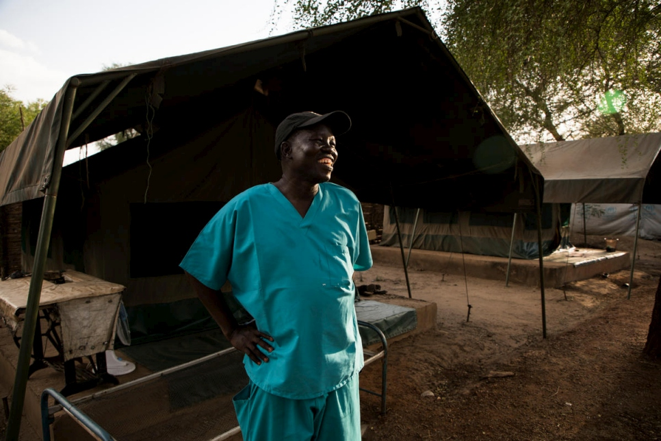 "Dr. Evan Atar Adaha outside his tent in Bunj, South Sudan. ""I am most happy when I realize that the work that I have done has saved somebody from suffering or has saved his life."""