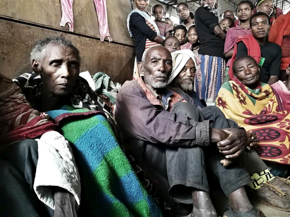 A group of people rest at the Yirga Chefe site for internally displaced people in Ethiopia.