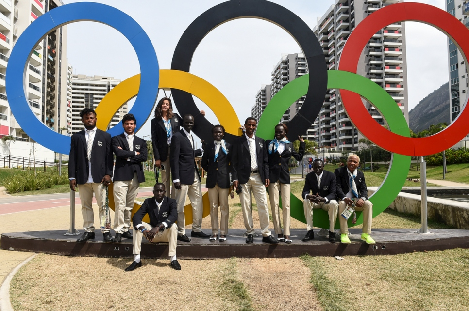Members of the Refugee Olympic Team and their coaches pose for a photograph in the Olympic Village in Rio at the end of an exhausting and electrifying 2016 Games.