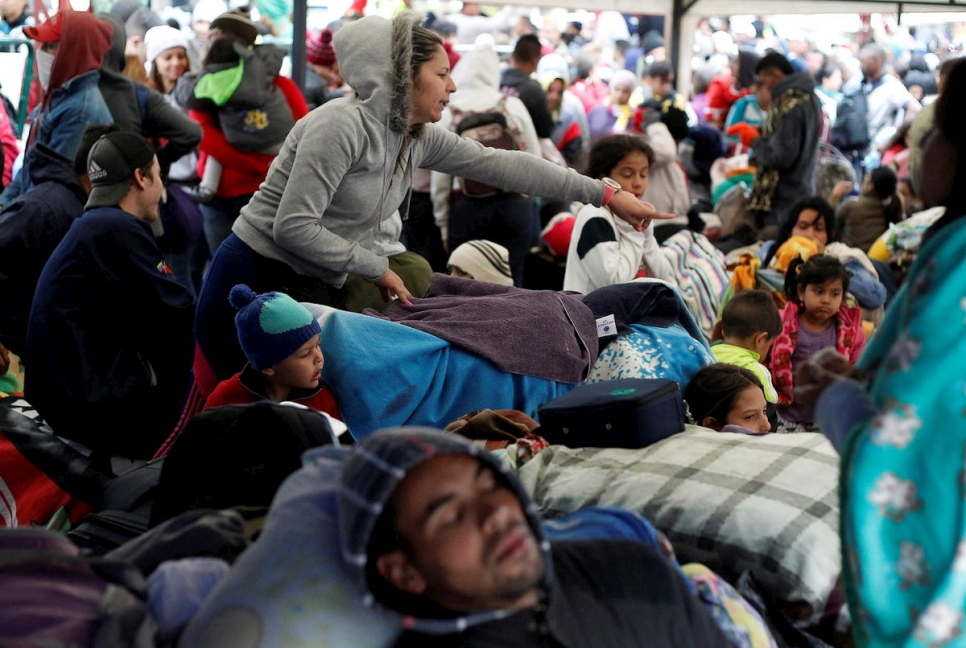 Colombia. Fleeing Venezuelans wait to register their exit from Colombia before entering into Ecuador, at the Rumichaca International Bridge.