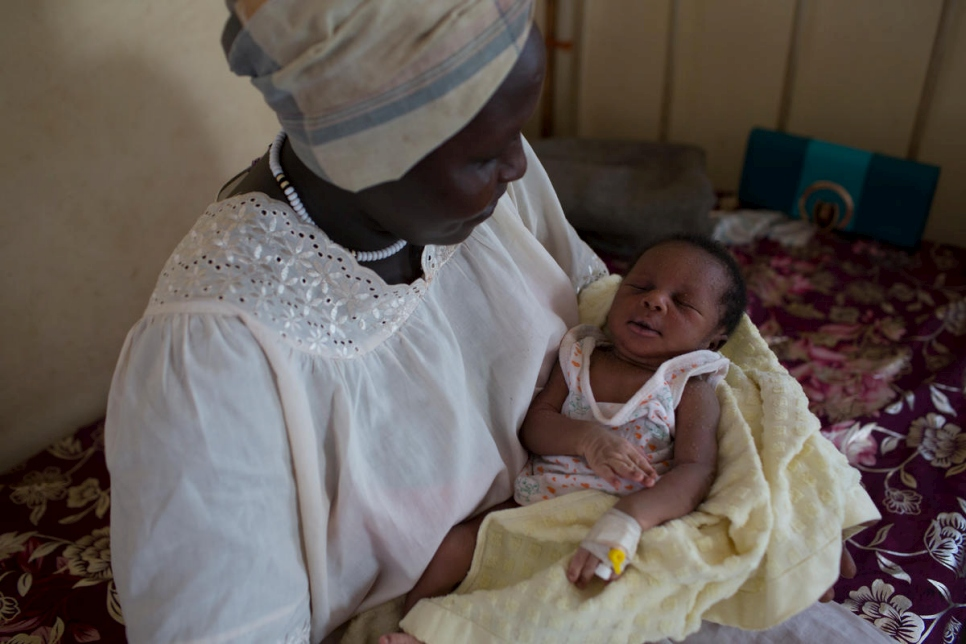 Sudanese refugee Gisma Al Amin sits with her newborn baby in the maternity ward of the Bunj Hospital in Maban County, South Sudan. The maternity ward has eight beds but can accommodate up to 20 cases if necessary.