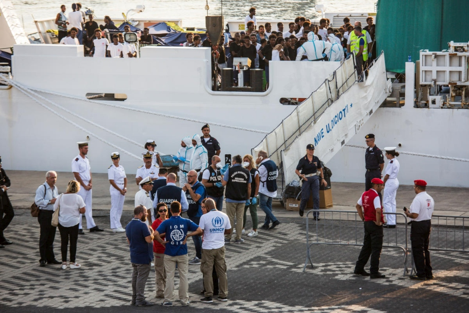 "Italy. 150 refugees and migrants on board the Italian Coast Guard ship ""Diciotti"", are allowed to disembark in the port of Catania after a 10 day stand- off."