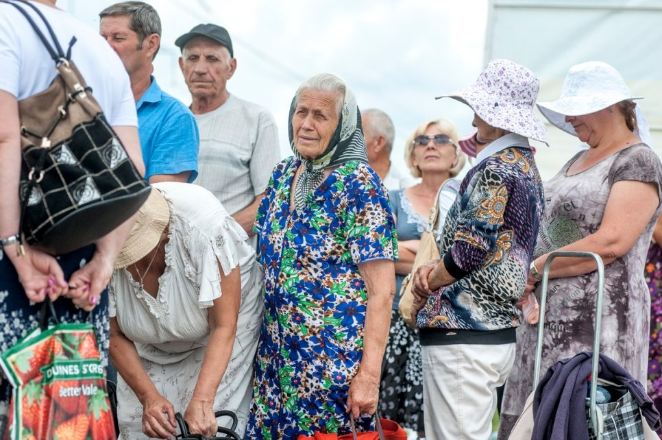 People queue at a checkpoint in Marinka, close to the conflict zone in eastern Ukraine, July 2016.