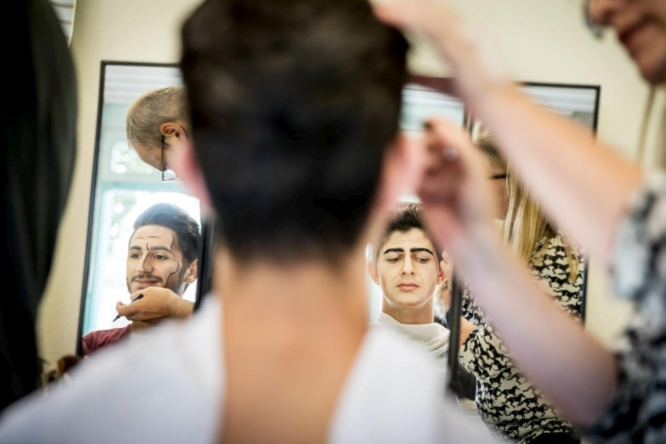 "Two of the six Syrian members of the cast, Koutaiba Al Rahmoon (left) and Omar Kodaimi, in makeup before rehearsals for Verdi's ""Don Carlos"" by opera company Zukunft Kultur."