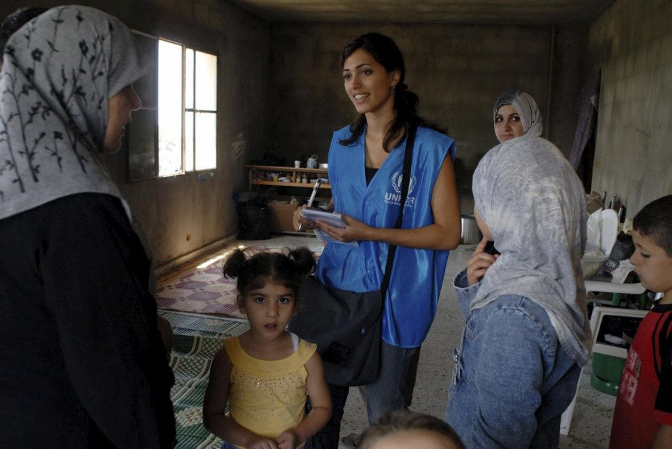 Lebanon / IDPs / Mouaysara community. Diana Menhem, 19, UNHCR field team talks to displaced people living in a school. / UNHCR / J. Matthews / August 2006