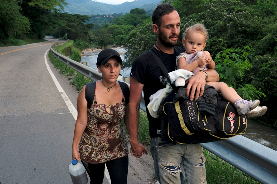 Luis and Magaly, a Venezuelan couple from Mérida, carry their daughter Izabella along a highway from the border city of Cúcuta. They are heading 450 kilometres south-west to the city of Tunja in the department of Boyacá, Colombia, where Luis has a job lined up in a mechanical workshop.
