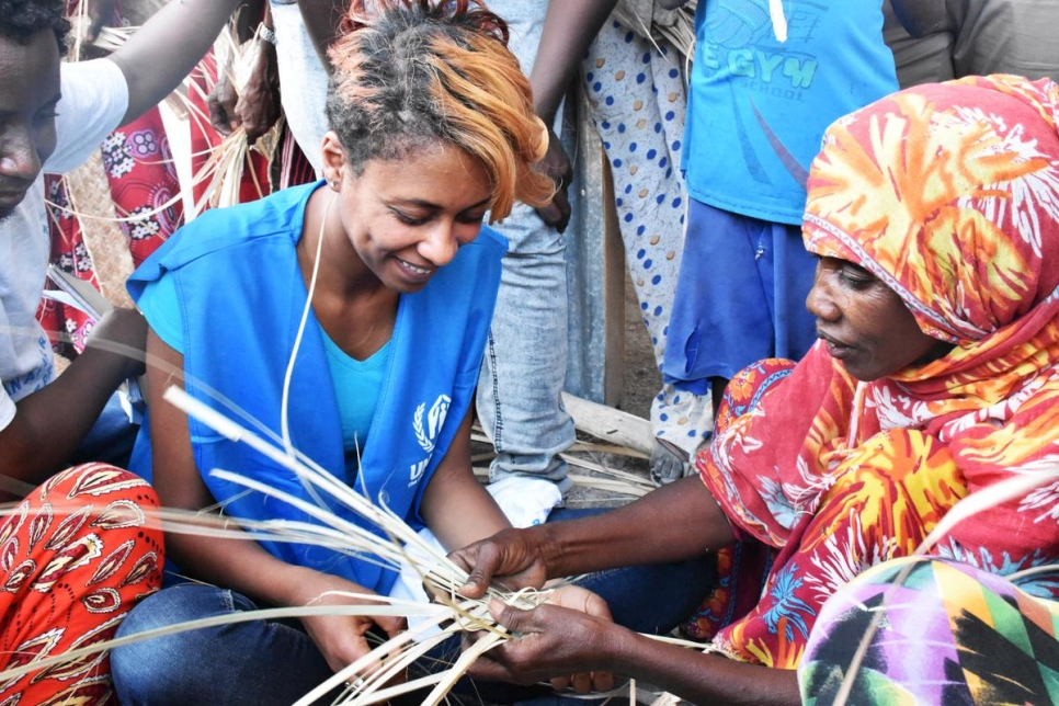 Betty G watches as an Eritrean refugee shows her how to make traditional mats in Aysaita camp in the Afar region of Ethiopia.