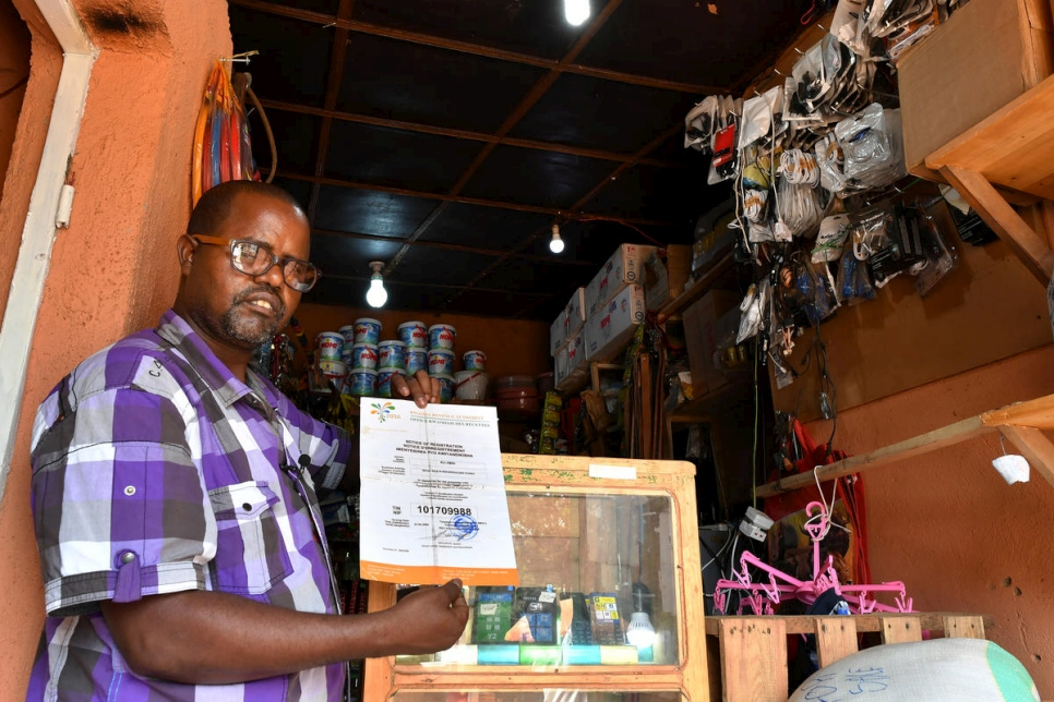 Rwanda. Somali refugee shop owner thriving thanks to integration