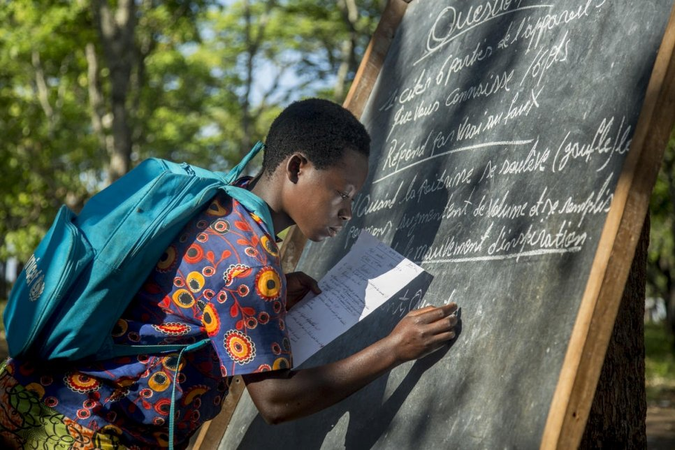 Tanzania. Refugee children battle the elements to learn