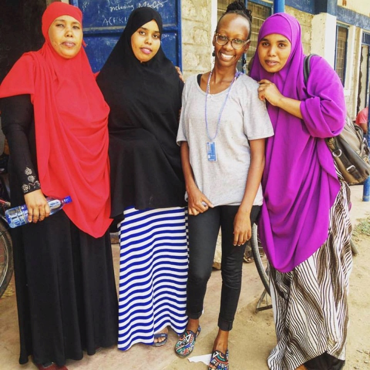 The writer with her Somali friends, Sahro, Aidhar and Suad in Kakuma camp, Kenya.