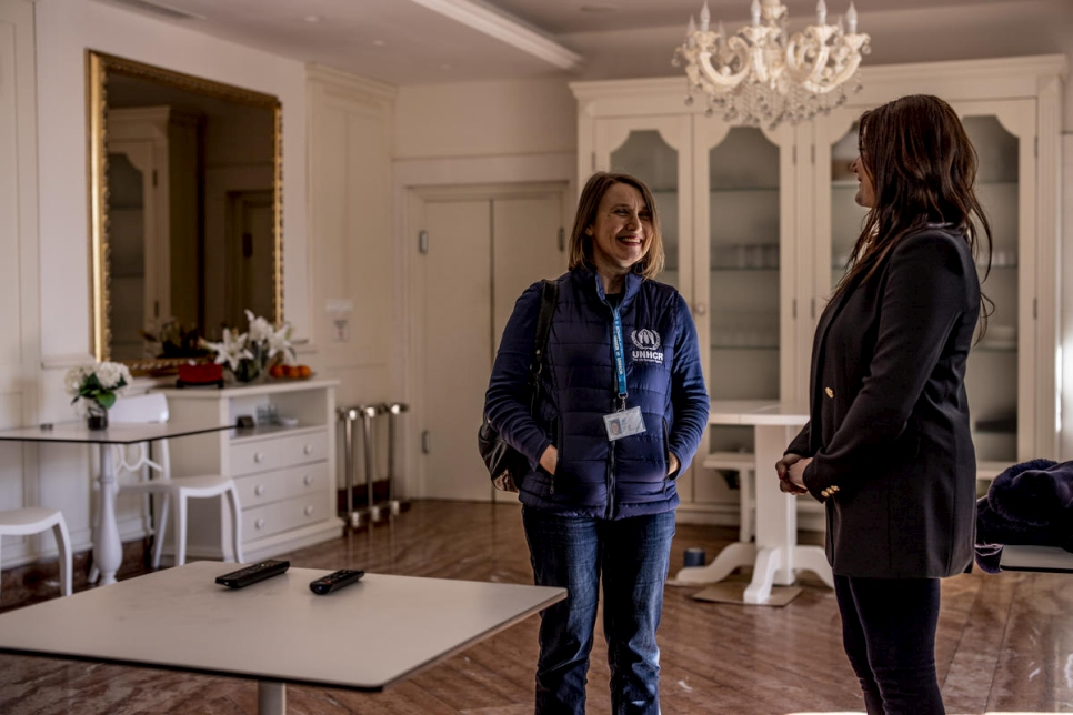 UNHCR Senior Protection Associate Darka Minic (left) talks with hotelier Simona.