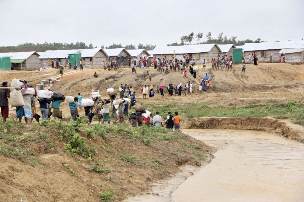 UNHCR staff and partners in Cox's Bazar, Bangladesh, relocate a group of Rohingya refugees from areas in the Kutupalong settlement at risk of landslides and floods to safer shelters in the Camp 4 Extension site.
