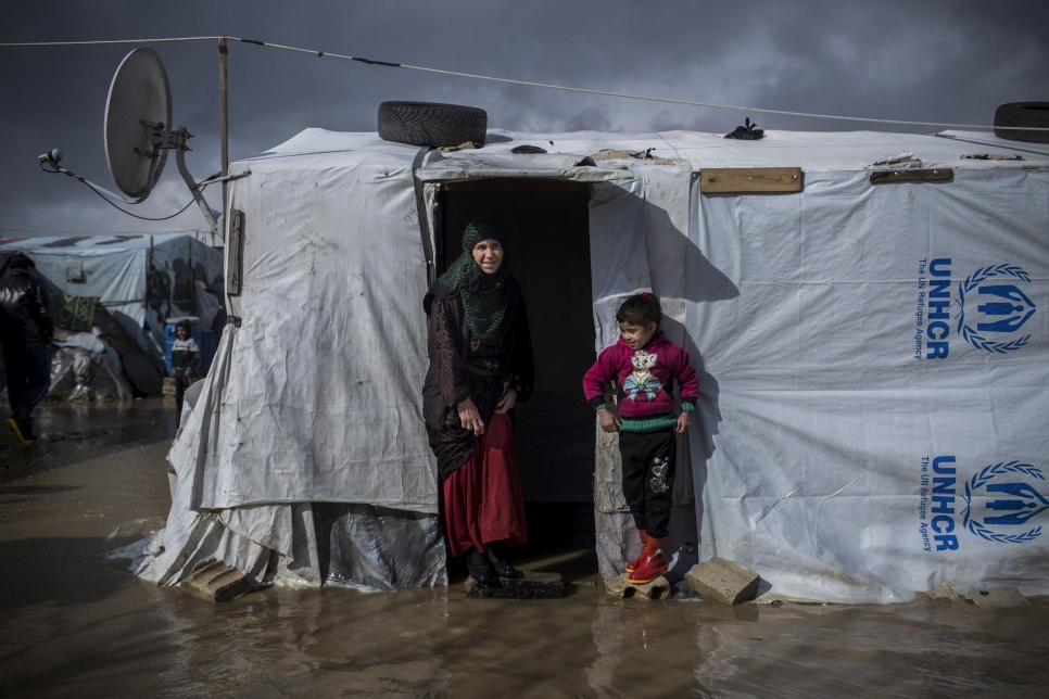 Portrait of Nuria and her daughter Ajar, Syrian refugees from Deir ez-Zor, outside their flooded home at the informal settlement of Dalhamiya in Bekaa Valley. They have been in Lebanon for the last 4 years and a half.