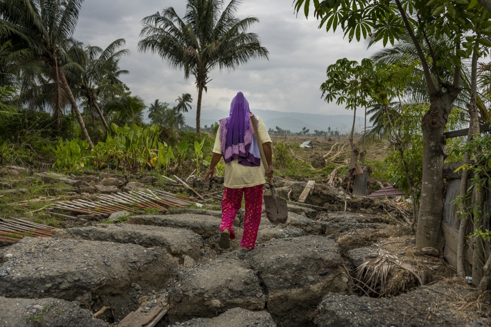 Earthquake survivor, Since, surveys the damage around her destroyed house in Petobo village, Palu, Central Sulawesi, Indonesia. The house was shifted 300 metres away from its original location by the liquefaction that followed a powerful tsunami.