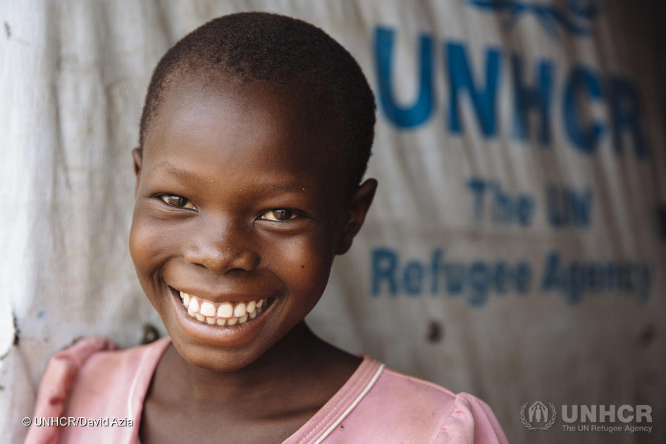 "Eight-year-old Saron, from Yei, South Sudan, at the Ofonze Primary School in Bidibidi refugee settlement, Yumbe District, Northern Region, Uganda.  ""I like math the most. I study hard so I can speak English,"" says Saron, who loves going to school and wants to be a doctor when she grows up, to help people."