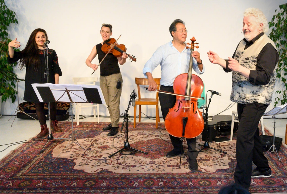 Vienna-based singer and Syrian refugee Basma Jabr, viola player Jelena Popržan, cellist Yo-Yo-Ma and artist Marwan Abado (from left to right) performing at an open music workshop in Vienna where people from across traditions, backgrounds and generations came together to play music and to make a statement for integration and social inclusion.