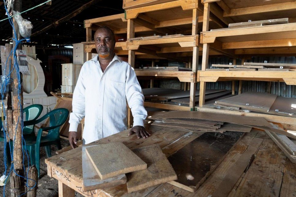 Somali refugee, Musa Yussuf Burey stands inside his furniture workshop in Melkadida, Ethiopia.