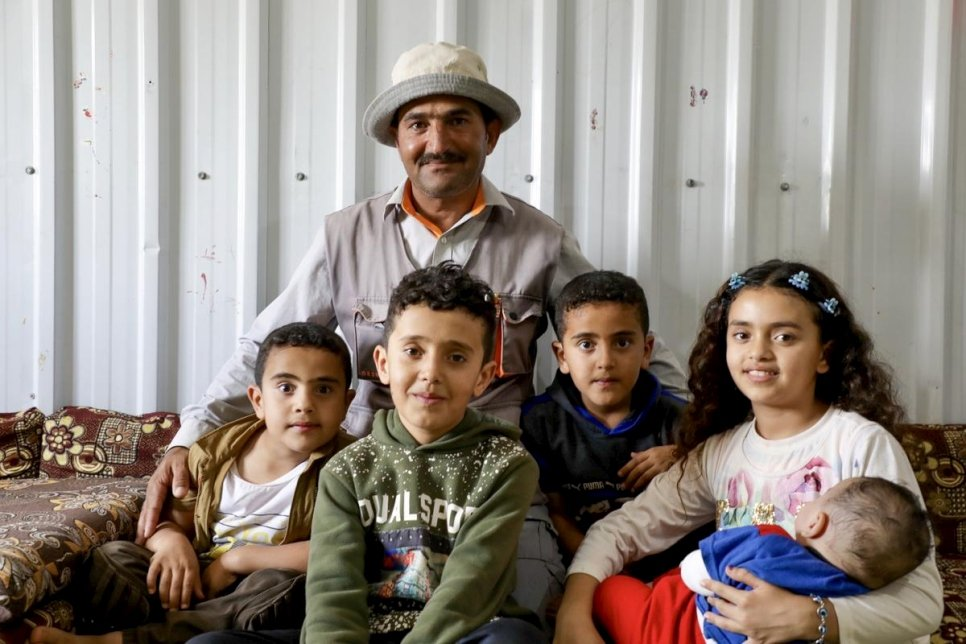 Euligio Baez, a Warao leader from Venezuela, poses with his family in Boa Vista, Brazil. © UNHCR