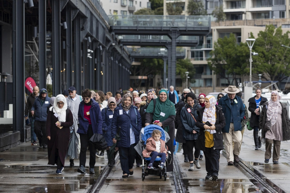 Australians walk together with their neighbours from refugee backgrounds around Sydney harbour to celebrate World Refugee Day.