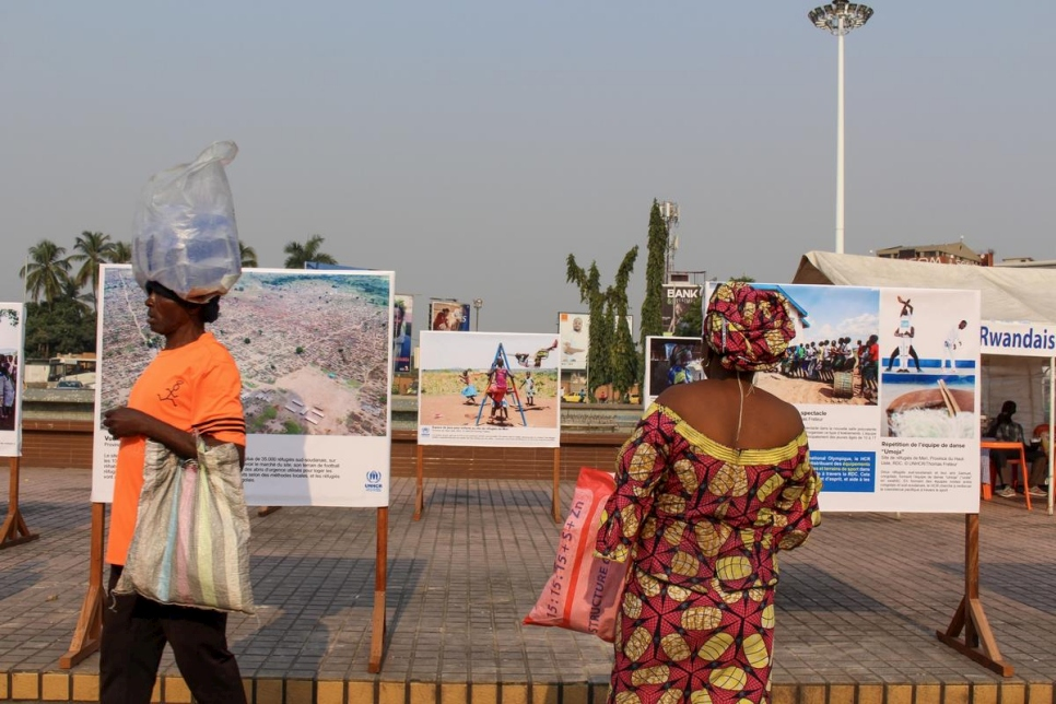 A Congolese woman looks at photos on display at the outdoor photography exhibition in downtown Kinshasa, DRC.