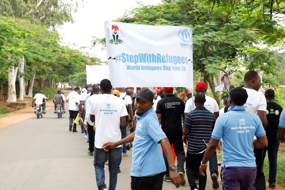 Residents of Ogoja in Nigeria's Cross River State take part in a \X6DStepWithRefugees walk to commemorate World Refugee Day.