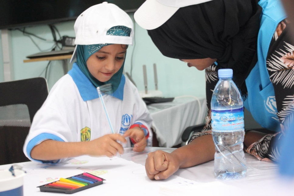 A child gets ready to work on a drawing at a fun day organized to mark World Refugee Day in Hargeisa.
