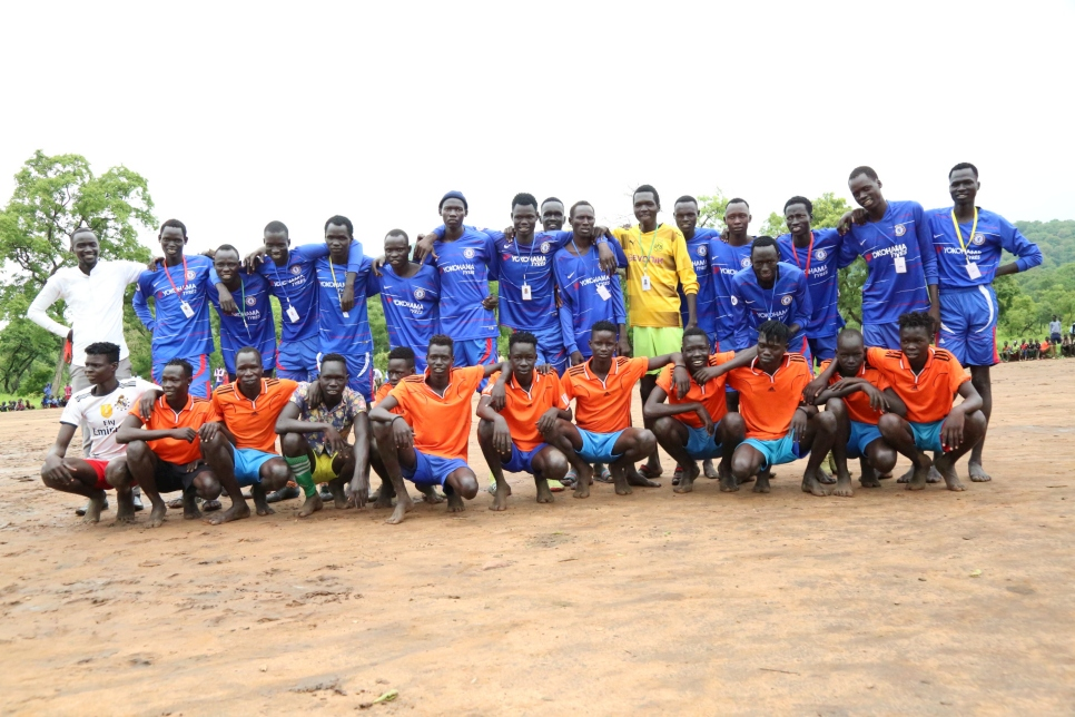 This football team made up of refugees and Ethiopians from the host community in Jewi, Ethiopia pose before their World Refugee Day friendly match.
