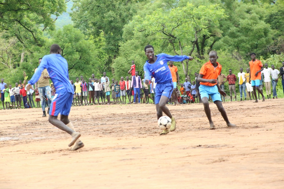 Refugees and Ethiopians play together at a World Refugee Day friendly match in Jewi, Ethiopia.