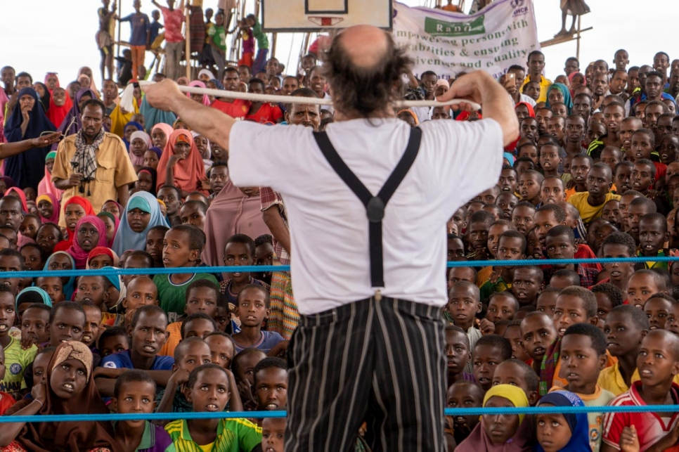 Part of the crowd watches in awe as a clown from Clowns Without Borders performs tricks in Melkadida camp, Ethiopia.