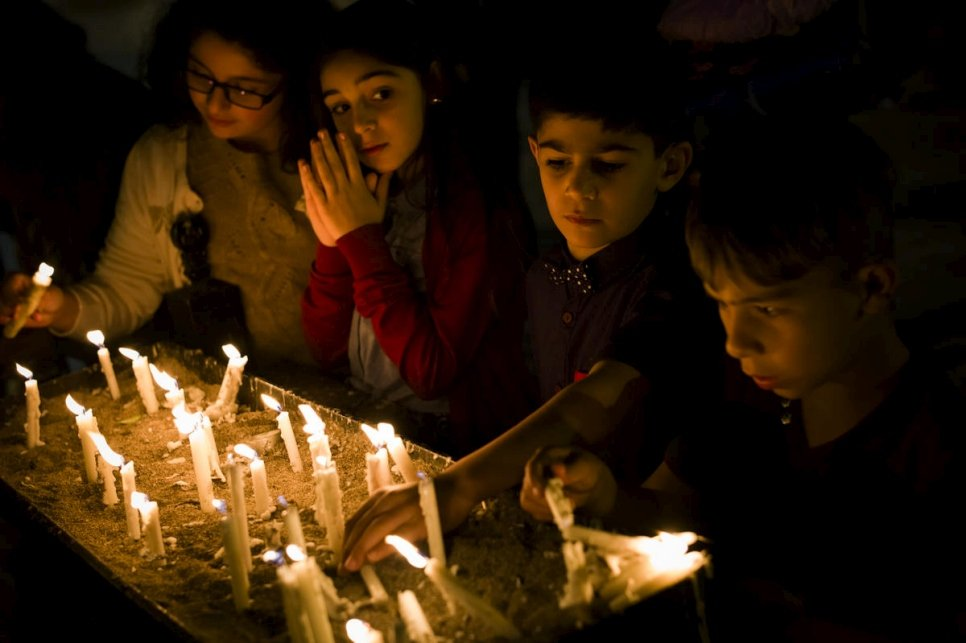 Iraq. Iraqi children light candles