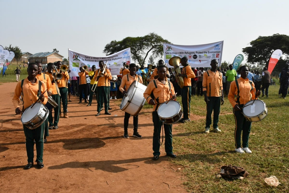A Ugandan brass band marches towards the World Refugee Day venue in Rwamwanja settlement, western Uganda.